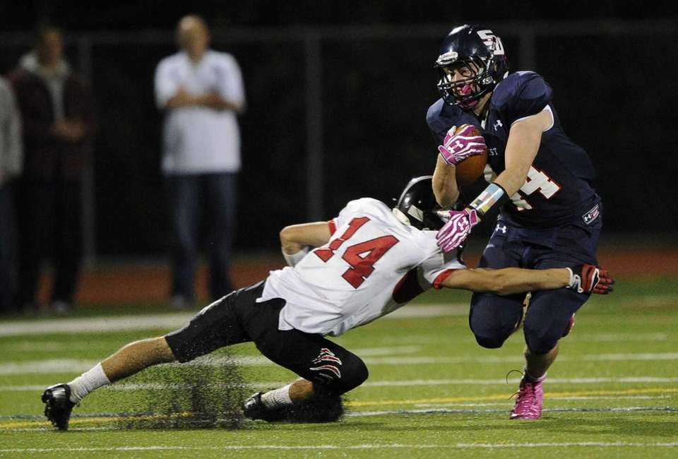 Smithtown West's Logan W. Greco is tackled by