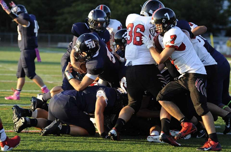 Smithtown West quarterback Matthew K. Heldberg Jr. takes