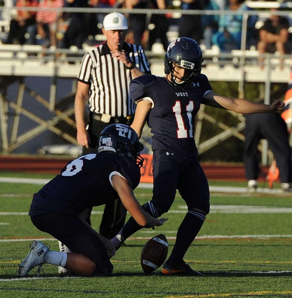 Smithtown West's John A. Pavacic kicks the football