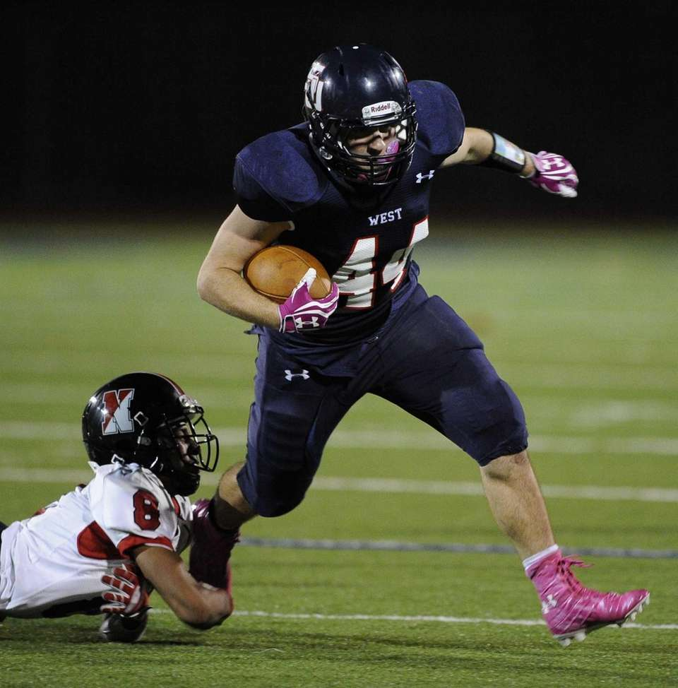 Smithtown West's Logan W. Greco breaks a tackle