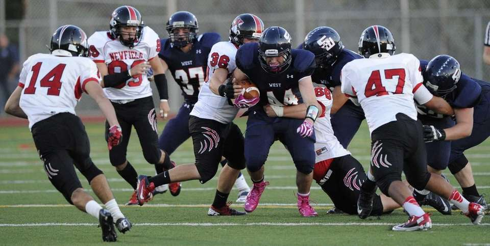 Smithtown West's Logan W. Greco, center, runs the