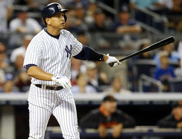 Alex Rodriguez of the Yankees follows through on
