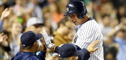 Alex Rodriguez of the Yankees celebrates his seventh-inning
