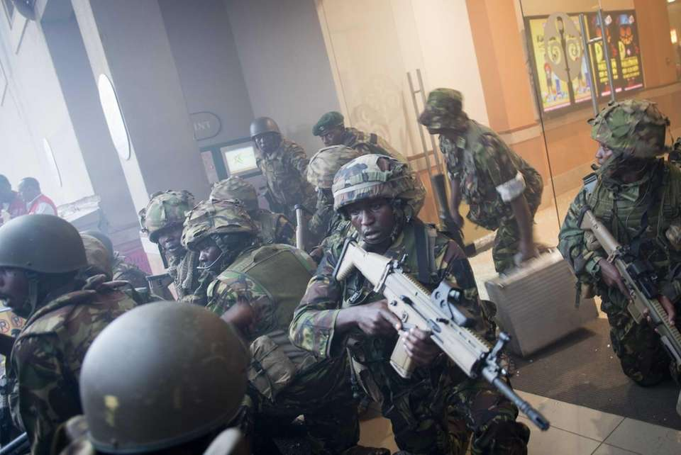 Armed police leave the Westgate Mall in Nairobi,