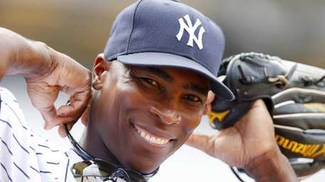 Yankees outfielder Alfonso Soriano looks on before the