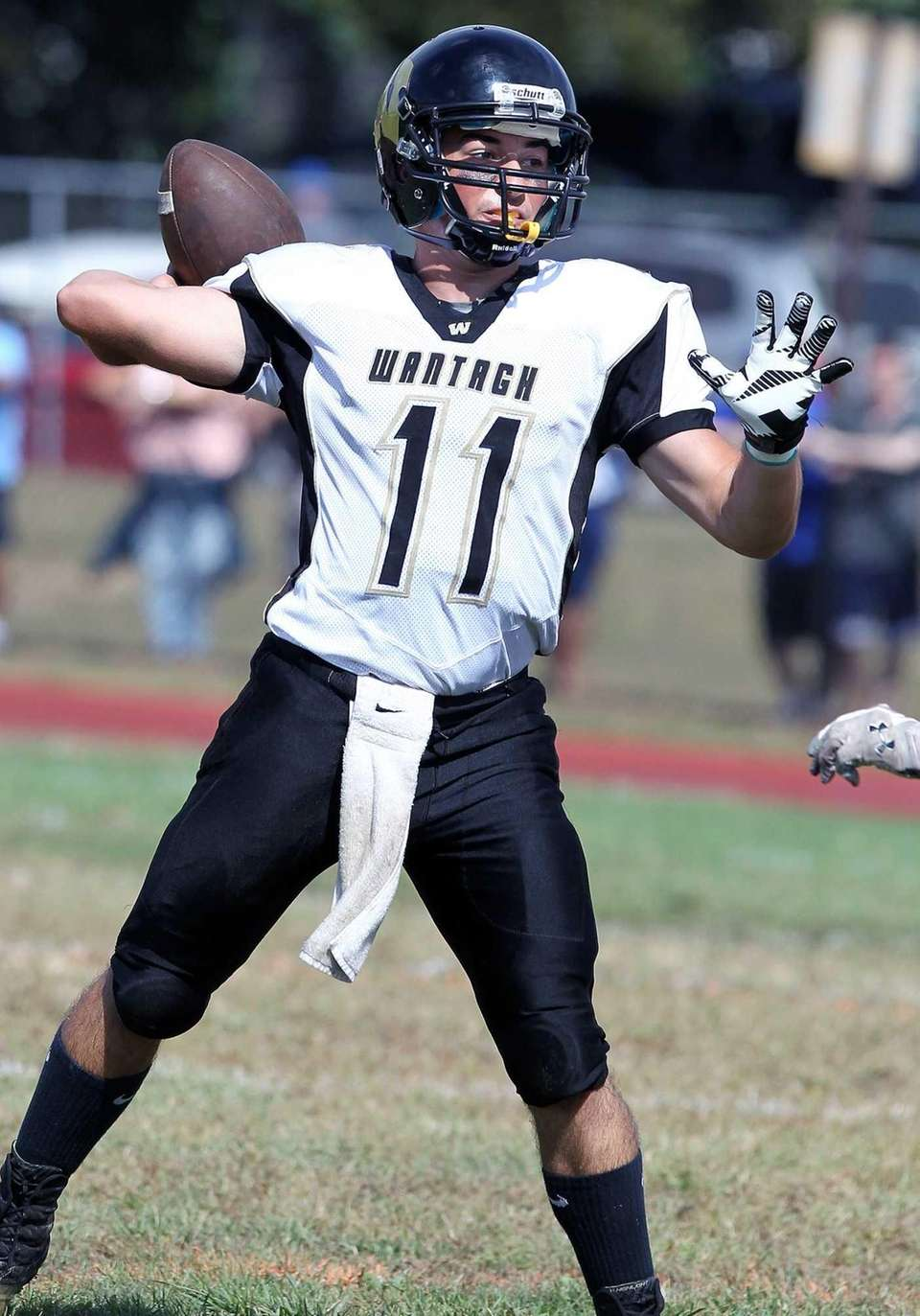 Wantagh quarterback Stephen Killard looks to pass against