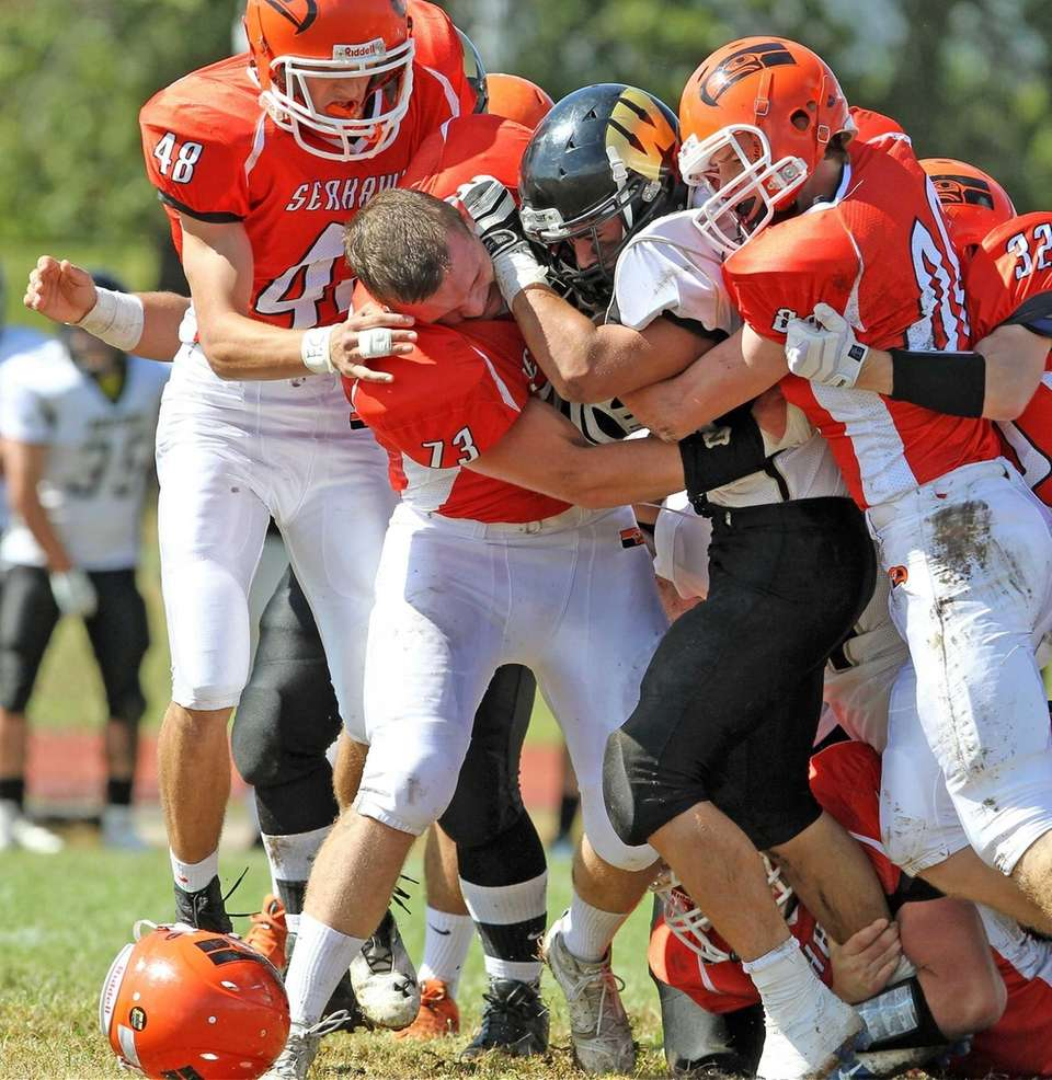 Carey's James Kadnar (no. 73) loses his helmet