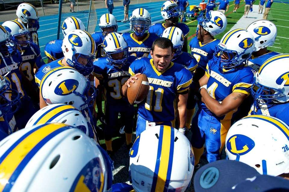 Lawrence quarterback Joe Capobianco talks to teammates prior