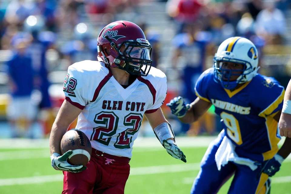 Glen Cove running back Billy Neice runs the