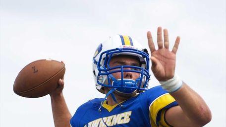 Lawrence quarterback Joe Capobianco warms up prior to