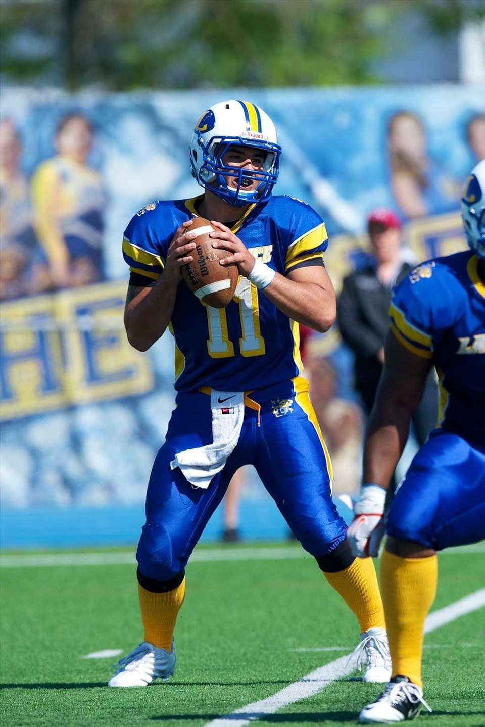 Lawrence quarterback Joe Capobianco looks to pass against