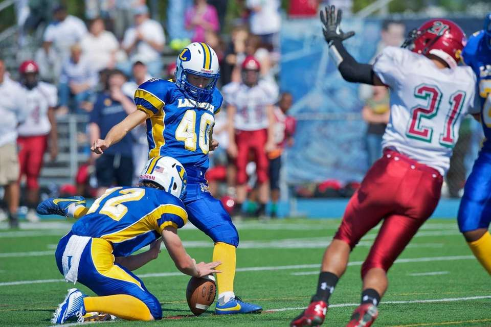 Lawrence kicker Dan Reiskin (no. 40) kicks an