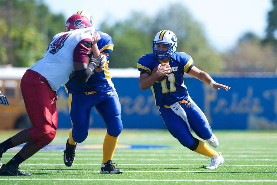 Lawrence quarterback Joe Capobianco runs the ball against