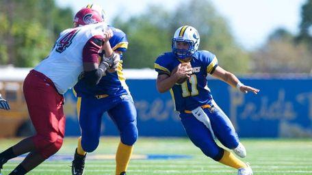 Lawrence quarterback Joe Capobianco runs the ball against