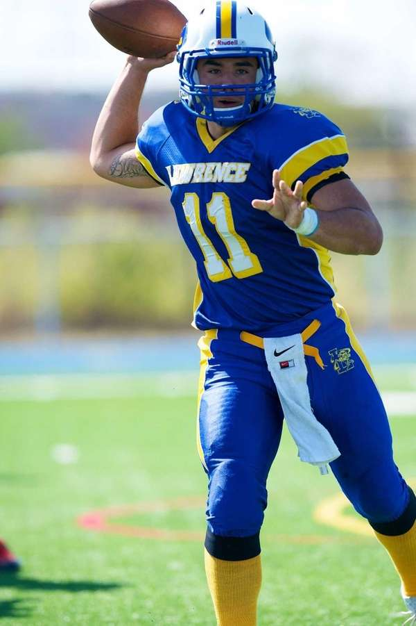 Lawrence quarterback Joe Capobianco attempts a pass against
