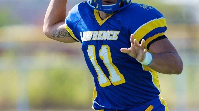 Lawrence quarterback Joe Capobianco attempts a pass against