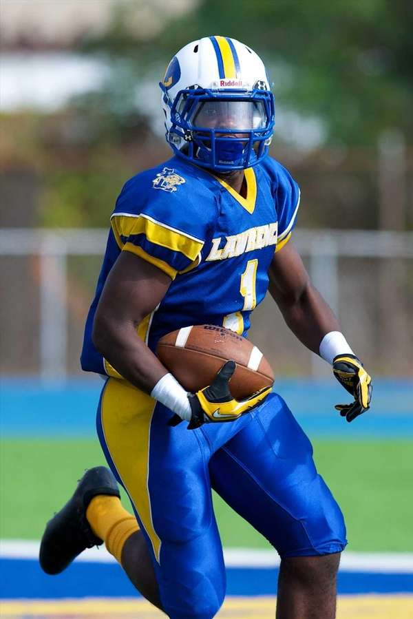 Lawrence receiver Jordan Fredericks runs the ball against