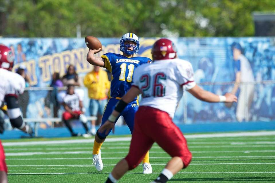 Lawrence quarterback Joe Capobianco attempts a pass to