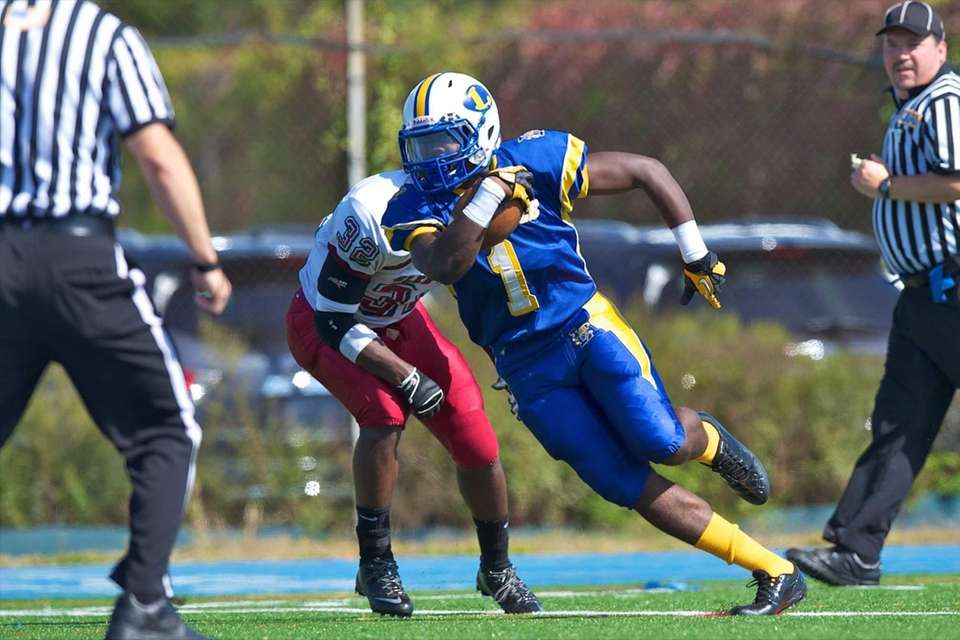 Lawrence receiver Jordan Fredericks runs the ball into