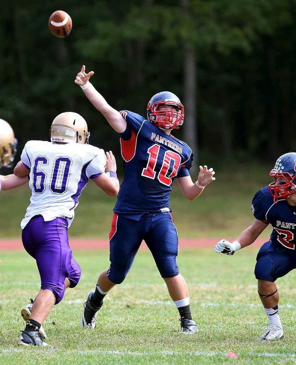 Miller Place quarterback Liam Walsh (no. 10) attempts