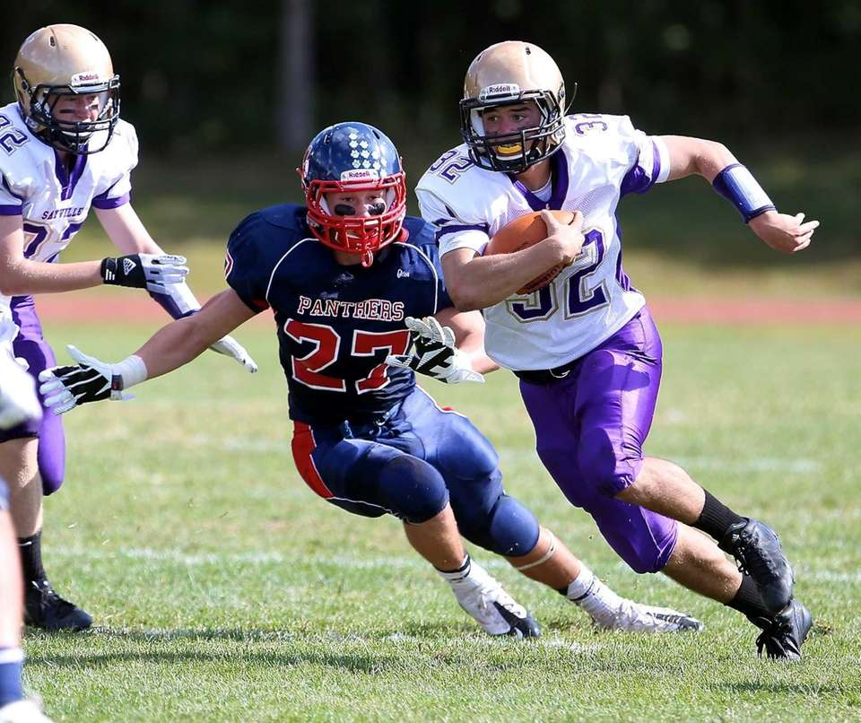 Sayville running back Matthew Selts (no. 32) cuts