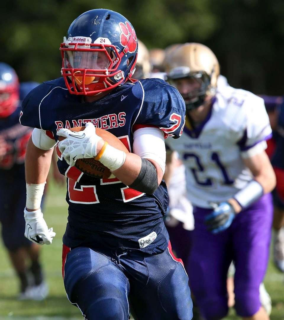 Miller Place running back Brett Osman heads down