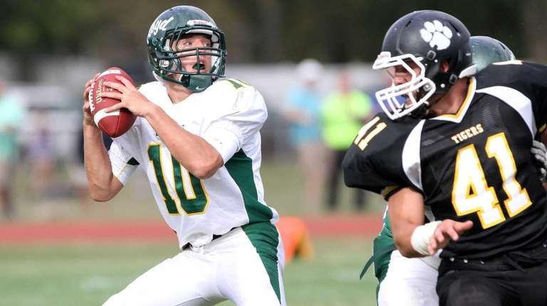 Floyd's Eric Brust drops back to pass in