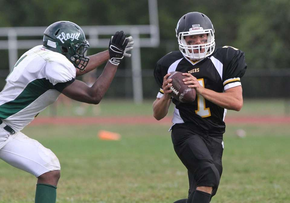 Northport's Connor Quinn is pressured by Floyd's Jawan