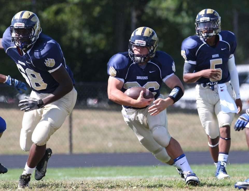 Baldwin's Nicolas De Luca, center, rushes against Hempstead.