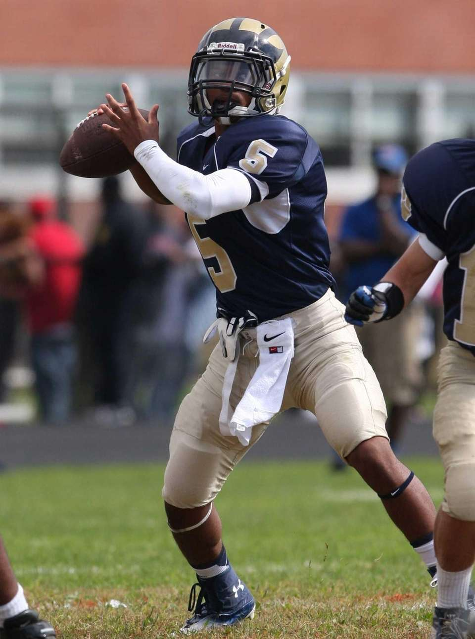 Baldwin quarterback Tyler Warner attempts a pass against