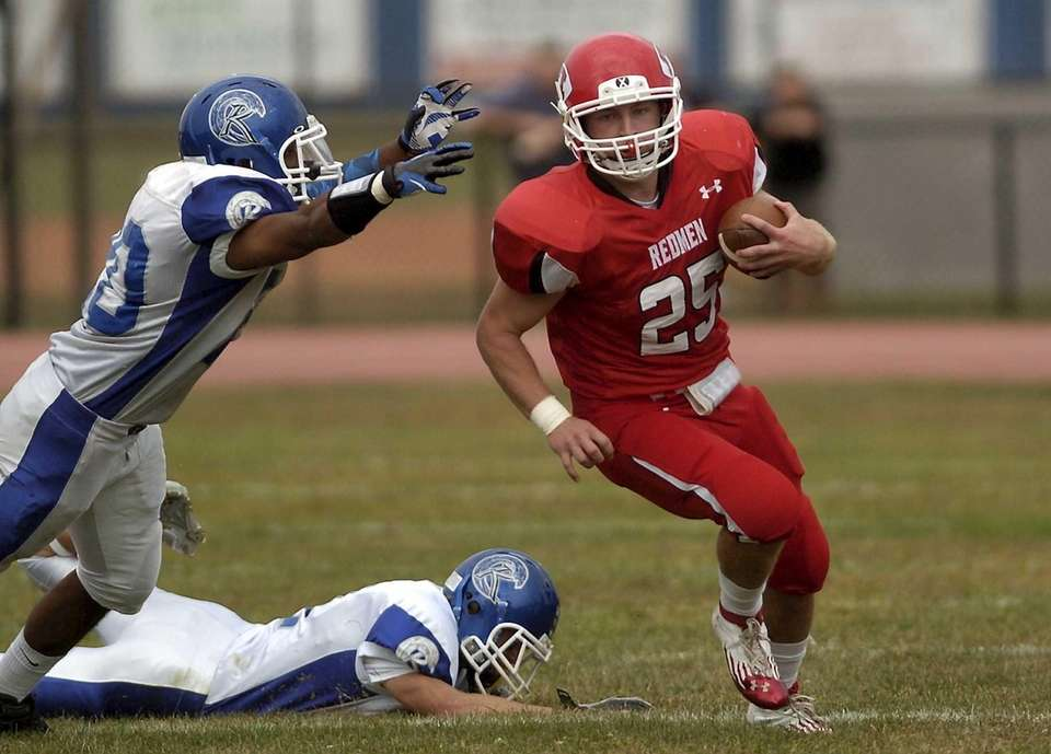 East Islip's Matt Walter carries against Rverhead. (Sept.