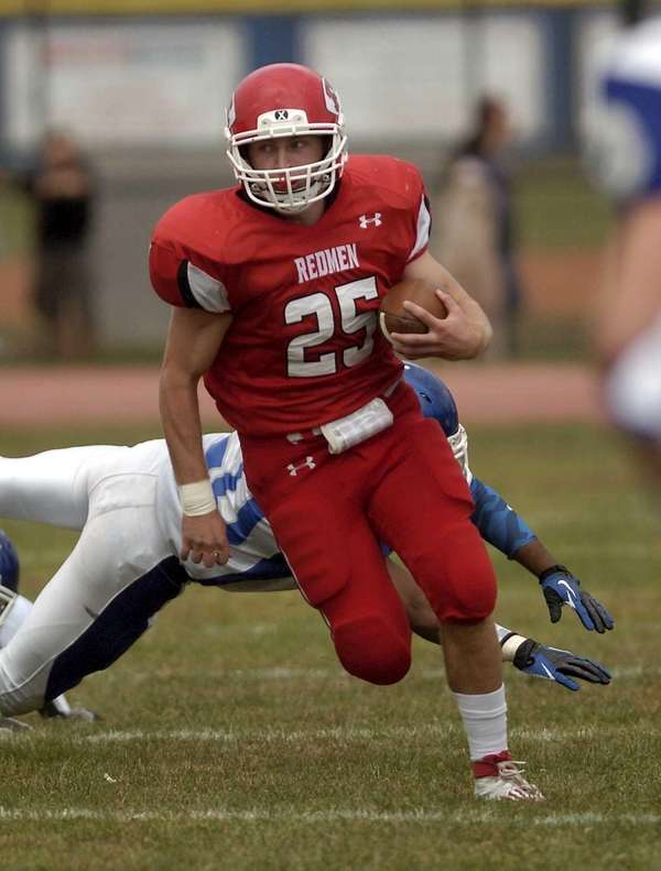 East Islip's Matt Walter carries against Riverhead. (Sept.