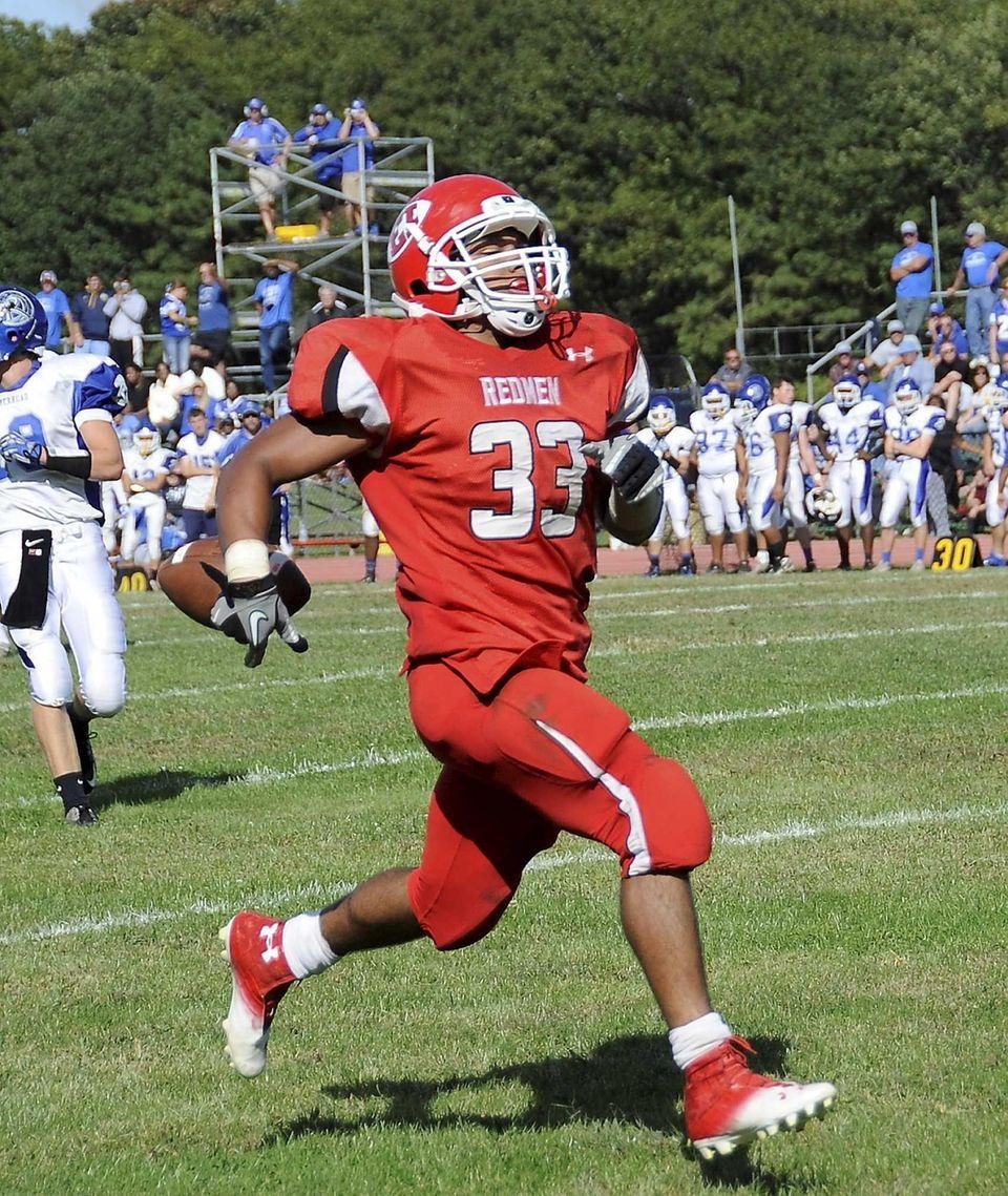 East Islip's Erik Adon runs for a touchdown