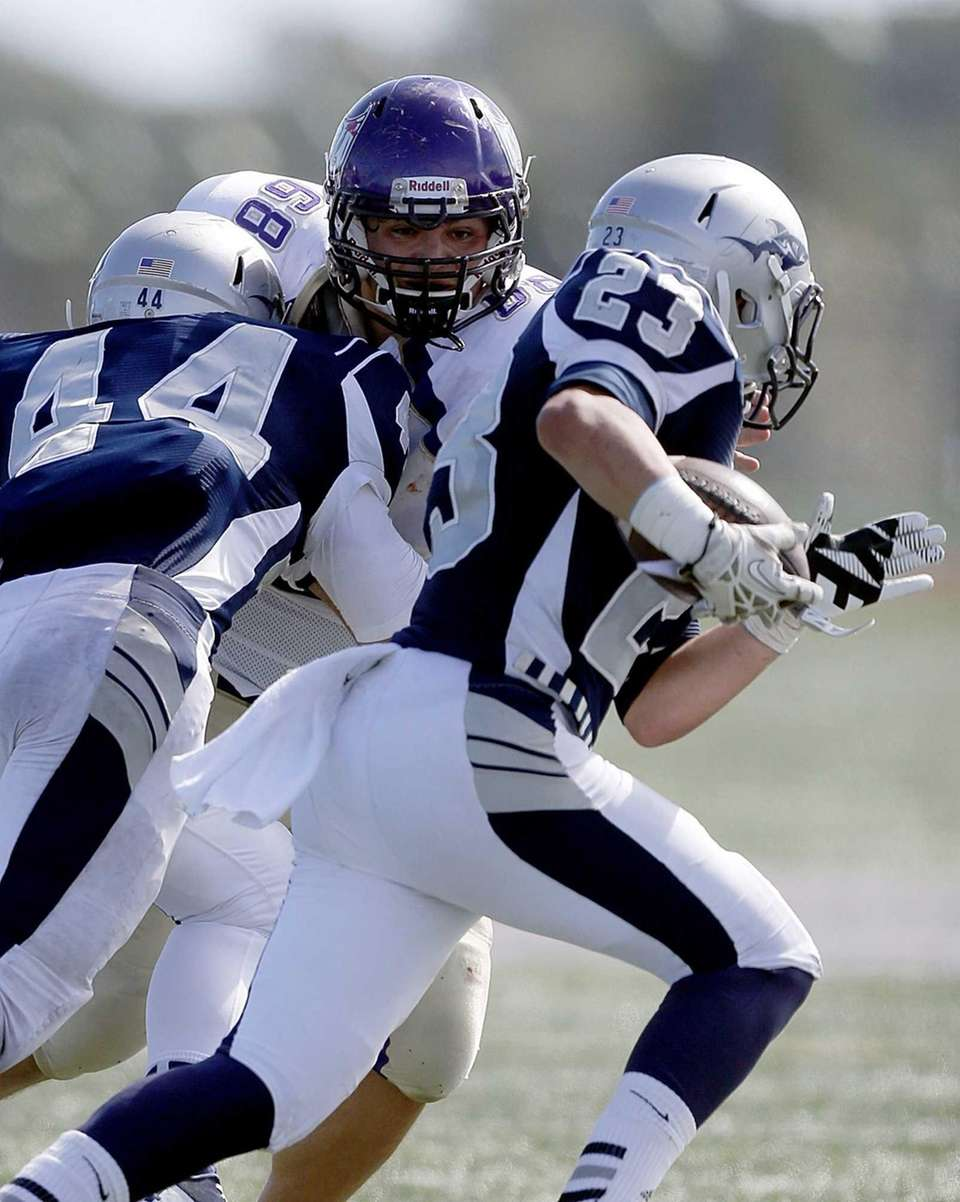 Islip defensive end Patrick Sheppard gets away from