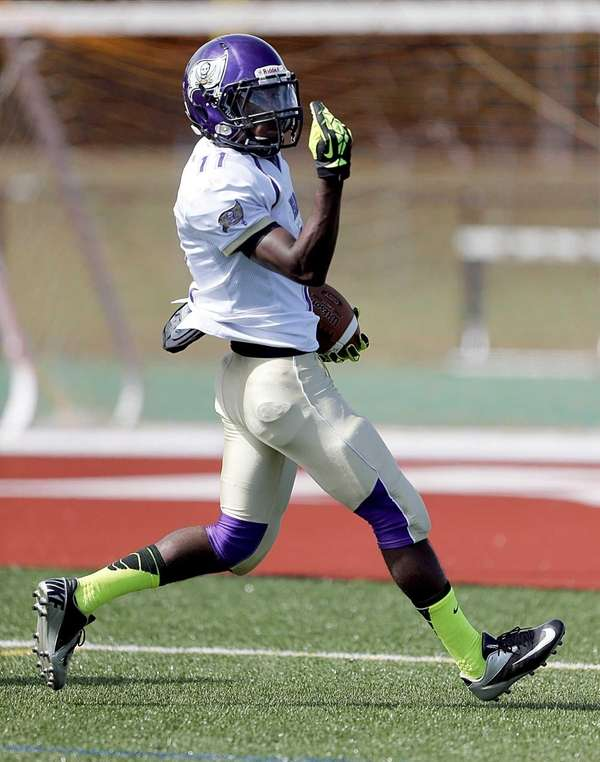 Islip's Wynell Michaud celebrates after scoring the game's