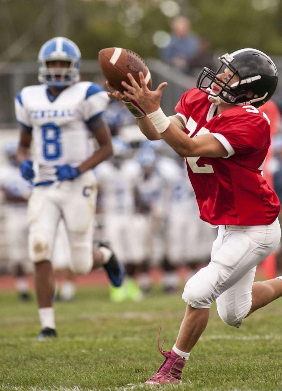 Syosset's Michael Elardo (right) makes a touchdown catch