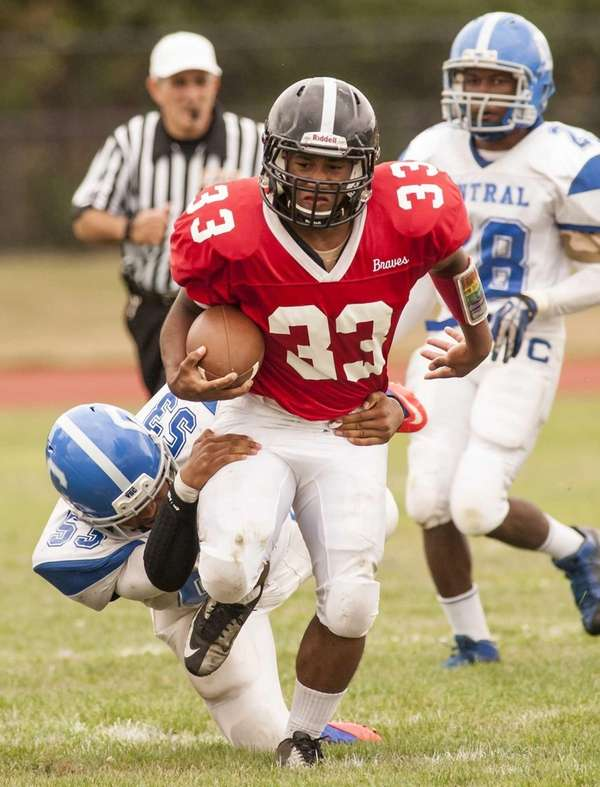 Syosset's Brandon Nieves (no. 33) runs against Valley