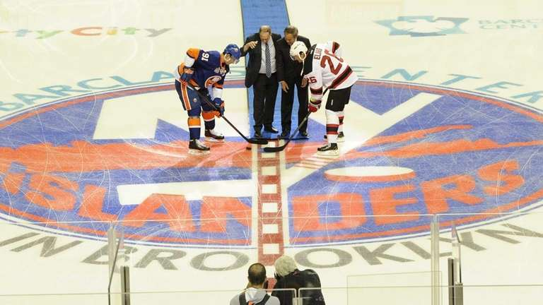 A ceremonial puck drop with Islanders owner Charles