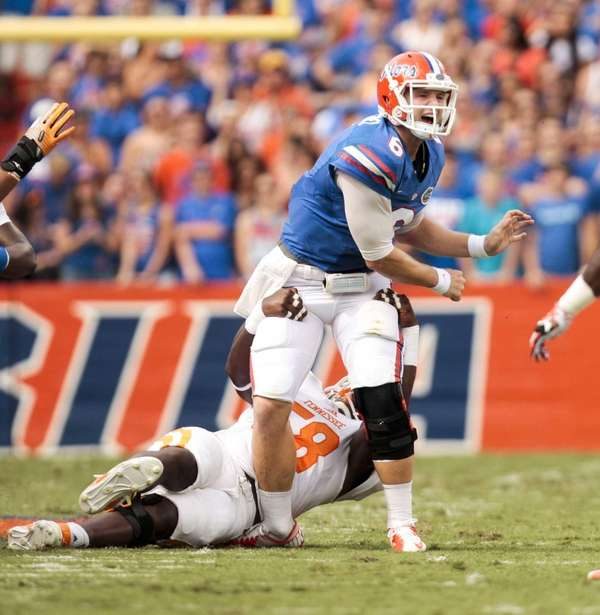 Tennessee defensive lineman Daniel McCullers, bottom, grabs Florida