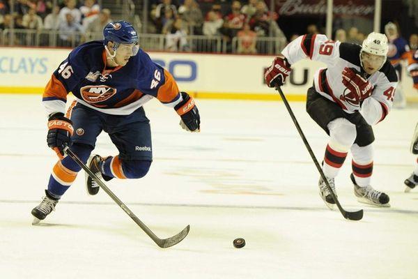 Islanders defenseman Matt Donovan chases the puck against
