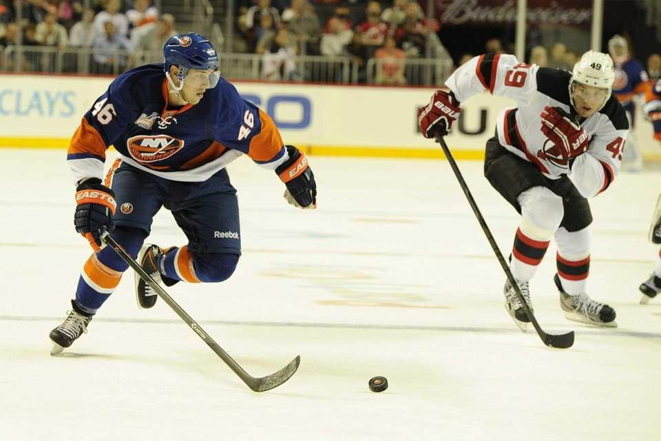 Islanders defenseman Matt Donovan chases the puck against