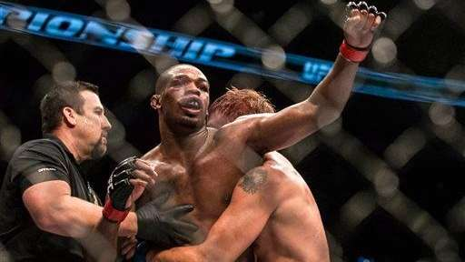 Jon Jones reacts as the referee after a