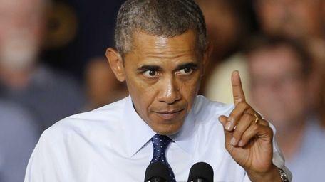 President Barack Obama gestures as he speaks to