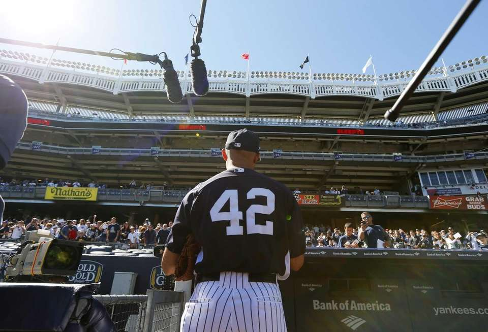 Mariano Rivera of the New York Yankees signs