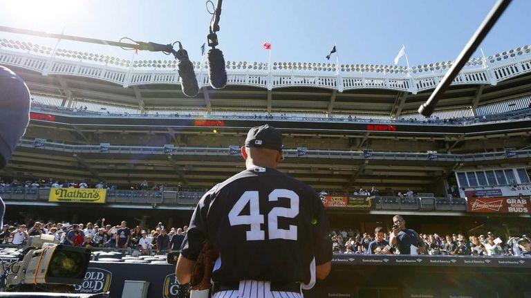 Mariano Rivera of the New York Yankees signs