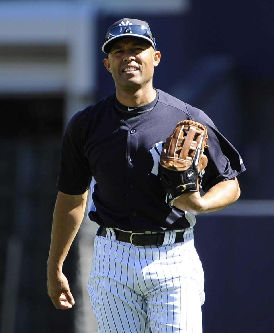 Yankees pitcher Mariano Rivera looks on from the