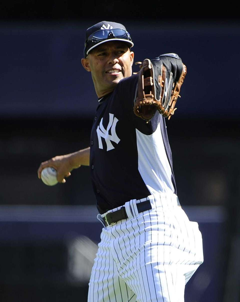 Yankees pitcher Mariano Rivera warms up on the