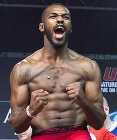 Jon Jones yells on stage after the weigh
