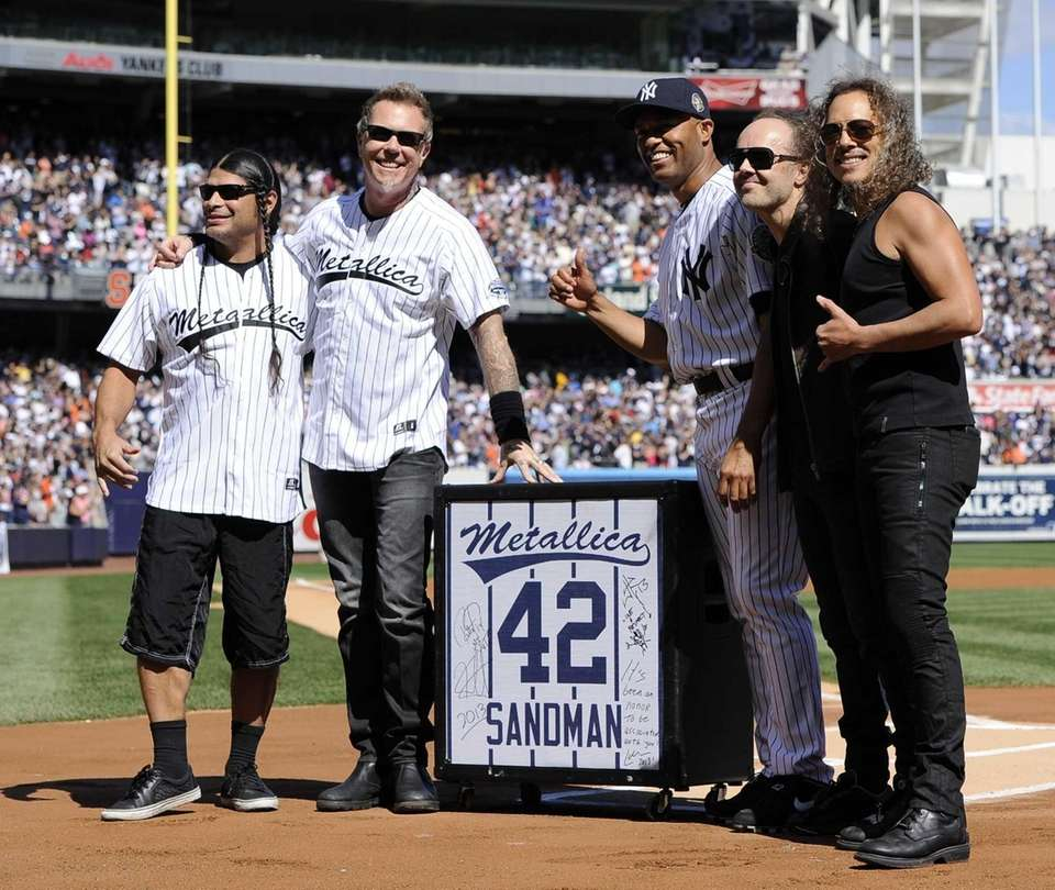 Members of the band Metallica present a gift