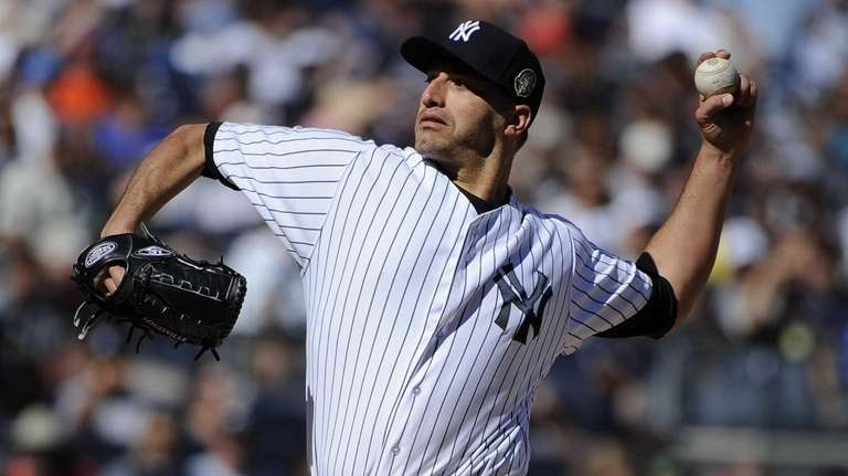 Yankees pitcher Andy Pettitte delivers against the San
